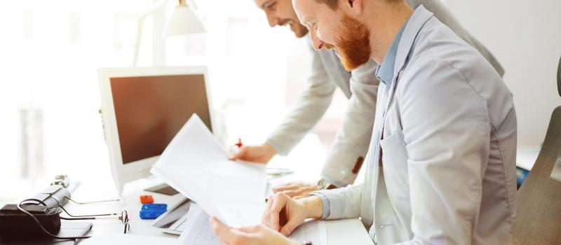 Coworkers planning startup goals